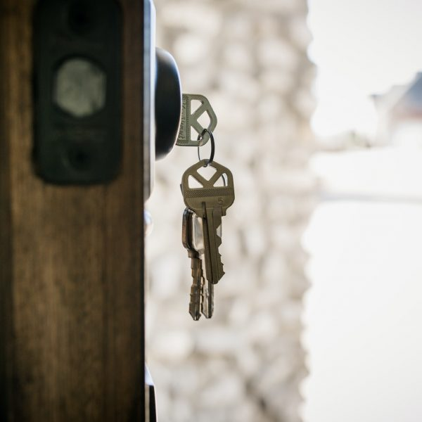 House keys hanging from door